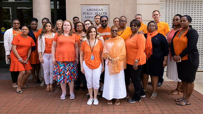 APHA staff in orange clothing