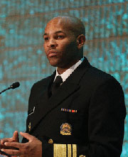 Surgeon General Jerome Adams at lectern