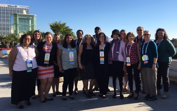 ISC Steering Committee members smiling for group photo outside in San Diego