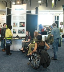 Annual Meeting attendees in wheelchairs at a poster session